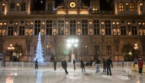 PARIS-JANUARY 9: The huge open-air rink and illuminated the Hotel de ville at night on January 9,2012 in Paris. Hotel de ville is the building housing the City of Paris's administration.